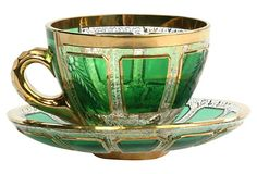 Moser apple green cut-to-clear crystal cup and saucer with wheel-cut engraved floral decoration and gilt trim. Made in former Czechoslovakia