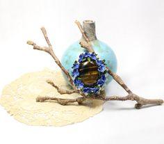 Deep blue crochet brooch with tiger-eye cabochon.Art от LozArts