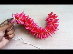 how to string arali flower garland in tamil Flower Garland Wedding, Paper Flower Garlands, Paper Flowers Craft, Bridal Flowers, Flower Crafts, Flower Decorations, Diy Flower, How To Make Garland, Diy Garland