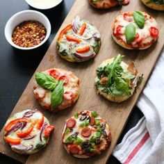 These Party-Friendly Mini Pizza Bites are the perfect injection of childhood fun for a grown-up get-together. Everyone gets to have a taste of what they like, and they are great in that they cater to everybody's dietary restrictions in a no-fuss manner. Pizza Bites, Bagel Bites, Holiday Appetizers, Appetizer Recipes, Appetizer Ideas, Healthy Appetizers, Tasty, Yummy Food, Mini Foods