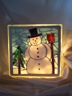 mosaic snow man glass block  (I haven't done this.)