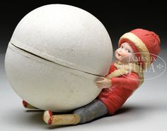 """FABULOUS GERMAN CHRISTMAS CANDY CONTAINER. Bisque headed boy holds giant snowball candy container. Boy has spun cotton body and clothing with bisque hands and head. Endearing hand painted character has impish side glancing expression. Head is marked """"3"""" on back side. Impressive piece for any Christmas collection."""