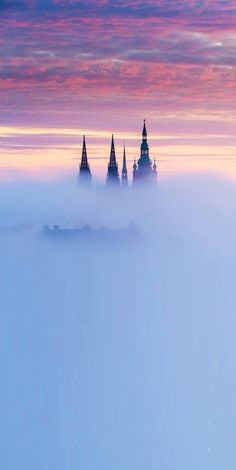 Prague, Czechia : the towers of St.Vitus cathedral standing out from the mist…
