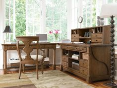 Like the set up - table under window, writing and storage next to it.