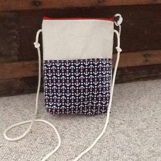 Handmade cross body purse, hipster, handbag made of a recycled Lake Superior Sail. It is made of white dacron sailcloth. One side is all sailcloth with