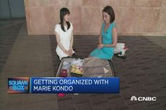 Author and consultant, Marie Kondo, shows CNBC's Akiko Fujita how to pack her suitcase by rolling her clothes and throwing out things that do not 'spark joy'.