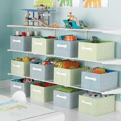 White elfa Activity Room Shelving or just do wire racks with boxes on either side of the windows Shelving Solutions, Toy Storage Solutions, Activity Room, Small Apartment Design, Home Daycare, Playroom Organization, Organizing, Toy Rooms, Kids Rooms