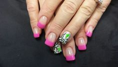 The Pink is colored acrylic. The ring finger designs are hand painted with acrylic paint.