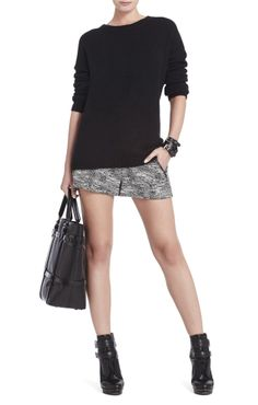 Balance out a short skirt with a chunky knit! If you're still feeling over exposed, an opaque tight will do the trick.