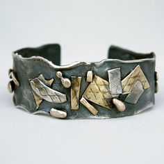Cuff | Cyndie Smith. 'Mixed' Oxidized Sterling silver with sterling silver, bronze and brass details. |  From: Etsy shop  cyndiesmithdesigns |  Via: etsy.com