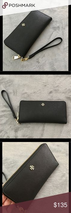 Tory Burch Robinson Zip Continental Wallet Preloved but in very good condition. Minor scratches on gold hardware. 218 with tax. A Tory Burch logo accents a Saffiano leather wristlet made to safely stow your on-the-go essentials. Zip-around closure. Optional wrist strap. Tory Burch Bags Wallets