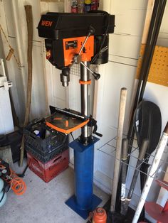Custom stand for bench-top drill press.