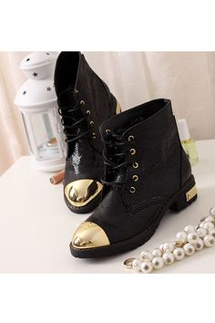 black snake skin boots with gold metal toes.