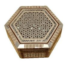 "Egyptian Mosaic Jewelry Trinket Box Mother of Pearl BX9 by CraftsOfEgypt. $20.50. Dimensions: 5.2X4.4X2 inch ( 13X11X5 cm ). Inlaid mother of pearl jewelry box made of wood. ""We use abalone, paua blue shells and white resin which are cut in small pieces The interior is lined with quality velvet. This box is ideal for jewelry or for home décor. """