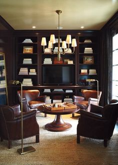 Built-in bookcases + dark rich palette in library space via H+H