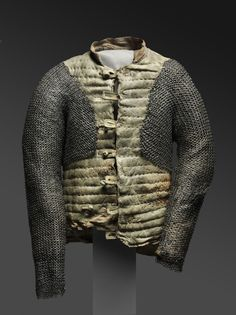 Arming Doublet  Artist/maker unknown, European. Repaired c. 1937 by Leonard Heinrich.  Geography: Made in Europe Date: c. 1550-1650 Medium: Leather, linen, flax fiber, steel, and brass.