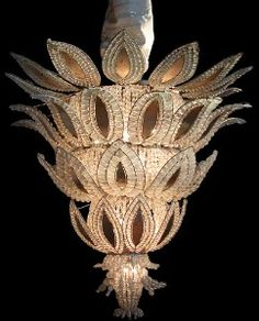 a magnificent french ananas art deco chandelier; attributed to 'bagues' white gold leaves with glass pearl beads mounted on silvered iron frame; rewired to accommodate north american standards; later gold leafing. provenance: grand hotel le royal, chalons sur saone. circa 1925