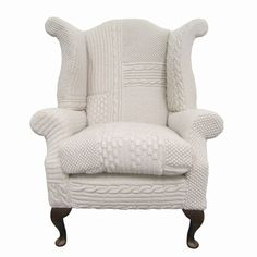 Dolly is a classic wingback armchair with stained wood legs. Covered in a patchwork hand-knit pattern. Seen here in Ivory. Can be made in any colours