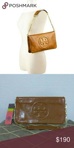 NEW Tory Burch Bombe Reva Clutch Shoulder Bag New with tags. Length 12 inches. Height 6.5 inches. Depth 1 inch. Chain strap 12-inch drop. Retail price$350 plus tax.   NO TRADES. PRICE FIRM. This is the lowest price. Ships within 1 to 2 business days. Tory Burch Bags