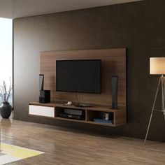 Stylish modern floating TV wall units that go along with your room decor. Make your living room classy with this floating TV wall units Tv Unit Decor, Tv Wall Decor, Wall Tv, Tv Cabinet Design, Tv Wall Design, Latest Tv Unit Designs, Wall Mounted Tv Unit, Hanging Tv On Wall, Tv Wanddekor