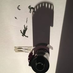 Belgian filmmaker and illustrator Vincent Bal works within the confines of long shadows of everyday objects resting in the sunlight to create a wide range of whimsical doodles. The shadow of a film canister becomes a forbidding tower, or the filaments of a lightbulb cast a dramatic backdrop as a sta