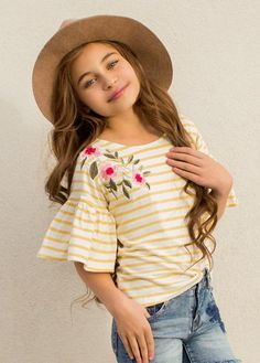 This top features a mustard yellow and white striped jersey fabric, a beautifully embroidered floral applique, and bell sleeves for a fun twist on your basic tee. Latest Tops For Girls, Stylish Tops For Girls, Striped Jersey, Petite Outfits, Yellow Stripes, Ruffle Top, Shirts For Girls, Floral Tops, Bell Sleeves