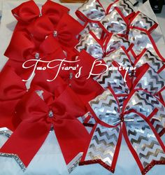 "Need red team cheer bows? Two Tiara's Bowtique on Etsy or join the Facebook group for recent updates and a lot more options.  I ship bows all over the US for peewee - varsity,  all-star,  and college.  These are for a varsity squad in Texas! I can customize to any size. They requested 6"" tails."