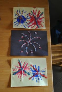 Handprint & Colored Rice Fireworks  { The Iowa Farmer's Wife }  What a perfect craft for the little ones  (and bigger kids too).  Make your handprints using paint,  then use glue and colored rice  for some added dimension.  (Simple directions for coloring rice is given in the post)