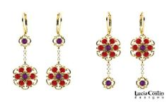 One Pair of Earrings with Two Versions by Lucia Costin with Dangle Flowers, Twisted Lines, Red and Purple Swarovski Crystals; 24K Yellow Gold Plated over .925 Sterling Silver; Handmade in USA Lucia Costin. $57.00. Produced delicately by hand, made in USA. Unique and feminine, perfect to wear for special occasions and evenings. Lucia Costin dangle earrings. Feminine floral design. Beautifully designed with light - siam and violet Swarovski crystals