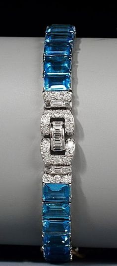 Heyman Brothers - A fine Art Deco aquamarine and diamond bracelet.