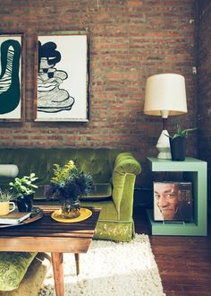 GREEN couch!! flowers, a shag rug, a Nelson bench AND a Bill Cosby LP... LOVE this room!