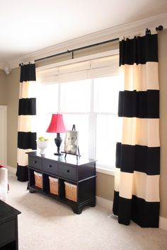 love the black and white curtains...probably would want something softer though...navy?