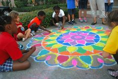 Rangoli is a decorative folk art from India that is created on the ground in front of entrances to homes, inside the homes, or in courtyards during celebrations to bring good luck and welcome Hindu gods and goddesses
