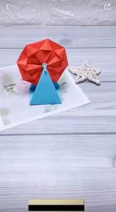 Origami ferris wheel project is a great way to work with a kid-friendly craft project at home. Cute Origami, Instruções Origami, Origami Ship, Origami Ribbon, Origami Horse, Origami Letter, Origami Elephant, Origami Envelope, Useful Origami
