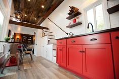 Red Kitchen Cabinets - Grand by Modern Tiny Living.  Love the storage stairs.