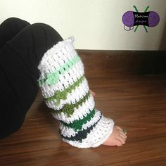 Who doesn't love dressing up for St. Patty's Day? Add a little pizzazz to your outfit with these fun Lucky Charm Leggies. Complete with ruffled edges, these legwarmers are so much fun! Pattern from Blackstone Designs #crochet #legwarmers #stpatricksday #fourleafclover #lucky