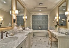 Bathroom. Marble detailing on the walls, counter tops and floor give this master bathroom a clean and classic look. Relax in the pedestal bathtub or enjoy a shower large enough for two. #Bathroom