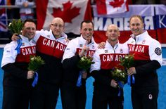 Gold medalists Caleb Flaxey, Ryan Harnden, EJ Harnden, Ryan Fry and Brad Jacobs of Canada celebrate during the flower ceremony for the Men's...