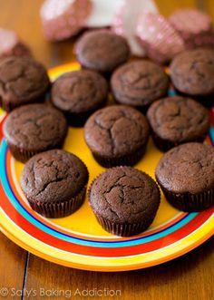 Death by Chocolate Cupcakes. Moist, rich, tender, and SO much fudgy flavor. sallysbakingaddiction.com
