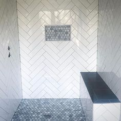 Herringbone subway tile with grey grout. Hexagon marble floor and shower niche. Proof a wimpy in size shower niche is the wrong choice when the tile in the niche is a focal point. Master Shower Tile, Gray Shower Tile, Subway Tile Showers, Shower Niche, Bathroom Showers, Subway Tiles, Master Bathroom, White Subway Tile Shower, Condo Bathroom