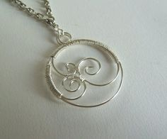 Triple swirl wirework pendant style