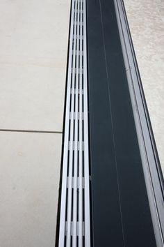 IQ Glass offer a flush drainage channel suitable for use with all our flush threshold doors such as our large sliding glass doors, bi-folding doors. Drainage Grates, Surface Drainage, House Extension Design, Extension Designs, Garage Door Threshold, Deck Drain, Drainage Channel, Glass Balcony, Roof Lantern