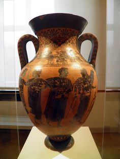 Etruscan Black-figure Amphorae: The Judgement of Paris and Dyionysian Procession, Italia Antiqua: Etruscans and Romans (Altes Museum, Berlin). Vulci (Italy). Clay, around 470 BC. Hermes with a ram on his arm. He is followed by three goddesses in Etruscan robes, yet without characterising attributes.