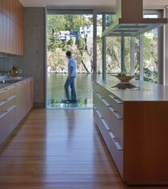 Modern Lakeside Kitchen      The architects of this home maximized the impact of its setting by framing the best views.    The kitchen's clean lines and minimalist decor allow the lake to take center stage. An abundance of wood and natural light keeps the space from feeling cold.