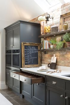Dark cabinetry can blend beautifully with wooden touches and white marble worktops, for an elegant yet rustic shaker style kitchen Kitchen Paint, Living Room Kitchen, Kitchen Design, Shaker Style Kitchens, Shaker Kitchen, Country Kitchens, Smallbone Kitchens, Kitchen Trends, Victorian Homes