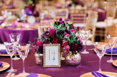 Love this purple centerpiece!  via TheELD.com