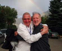 Errol Morris and Werner Herzog share a hug under a rainbow - what a wonderful world!
