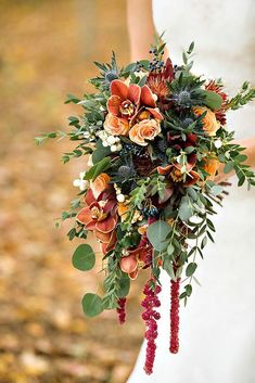 Not into the cascading bouquet but like the orange/red/green combo. trailing autumn wedding bouquet - copper inspired wedding bouquet by prestige floral studio Bouquet En Cascade, Cascading Wedding Bouquets, Fall Bouquets, Fall Wedding Bouquets, Fall Wedding Flowers, Bridal Flowers, Flower Bouquet Wedding, Floral Wedding, Red Wedding