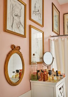 pink bedroom with frames
