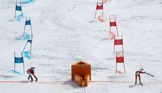 Alpine Skiing - Pyeongchang 2018 Winter Olympics - Team Event - Yongpyong Alpine Centre - Pyeongchang, South Korea - February 24, 2018 - Wendy Holdener of Switzerland (R) and Katharina Gallhuber of Austria compete. REUTERS/Stefano Rellandini